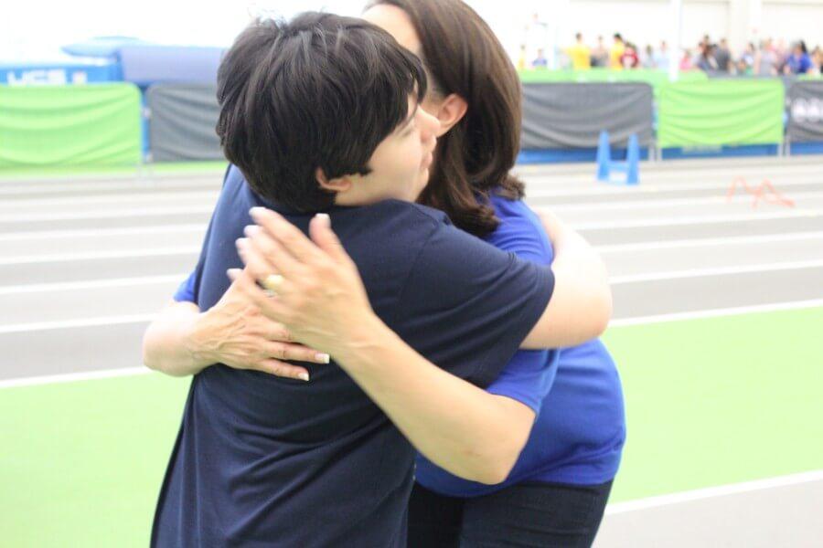 Program Participant Hugs Specialist