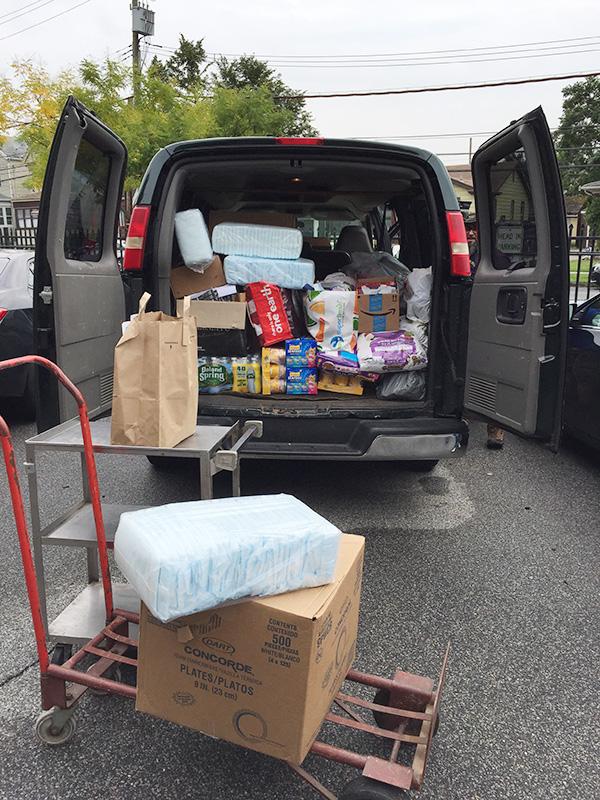 Back View of Open Van Full of Supplies